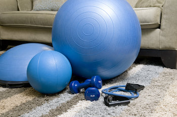 Gym balls, balance balls, dumbbells and resistance bands all ready to use at home